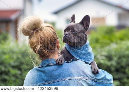 Woman Holding French Bulldog Dog Over Shoulder