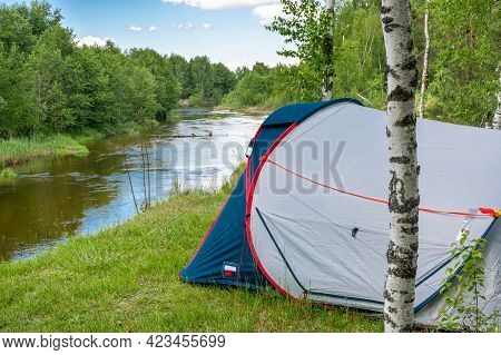 Camping Tent In A Forest By The River. Tourist Tent In Forest. Tourist Background. Nature Tourism, L