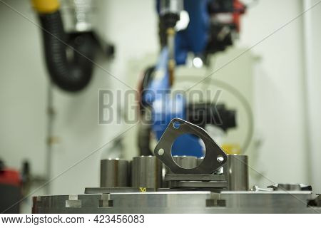 Blurred Image Of Welding Factory, Industrial Robot Is A Welding Test Program In A Car Factory.