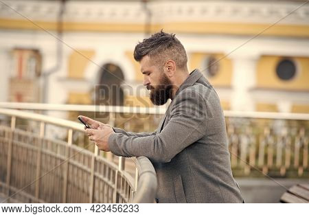Enjoy Mobile Phone Services Here. Bearded Man Email Or Sms From Smart Phone. Mobile Blogging. Commun
