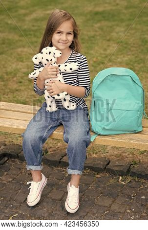 Play, Learn And Grow. Happy Kid Play With Toy Dog Outdoors. Child Development. Preschool Education.