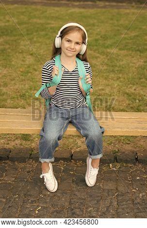 School Holidays. Cute Kid Sit On Park Bench. Preschool Education. Summer Holidays. Music Fun. Trip A