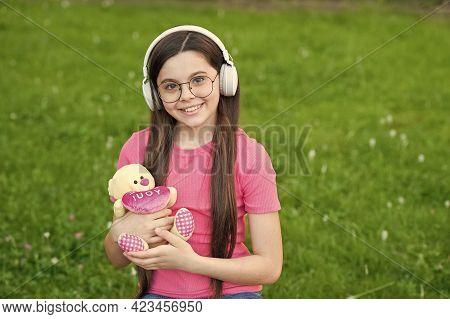 Big Bear Hug For You. Valentines Girl Hold Teddy Bear On Green Grass. Small Child Got Valentines Gif