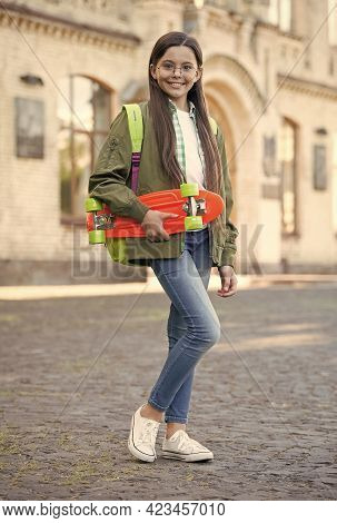 Cruise Till You Can Cruise No More. Happy Child Hold Penny Board. Little Skater Smile Outdoors. Ridi