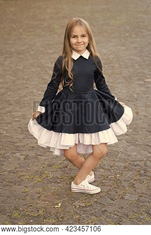 Elegant And Classy. Happy Child Make Curtsy In Uniform Outdoors. Dress Code. Formal Style. Fashion S
