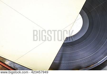 A Stack Of Old Vinyl Records Close Up One Of The Records Is Half Out Of The Envelope