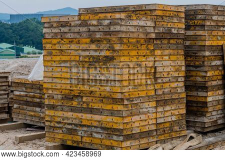 Metal Masonry Forms Stacked Neatly On Hillside At Construction Site.