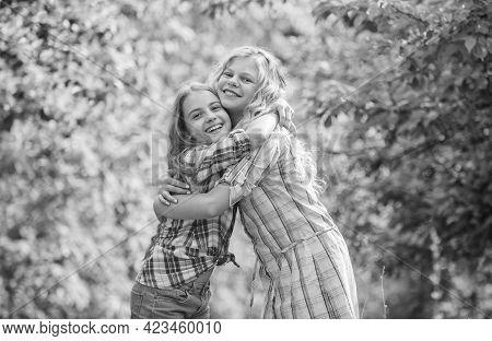 True Friendship. Girls Smiling Happy Faces Hug Each Other. Girls Children Best Friends Hug. Sisterho