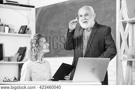 Communicate Clearly And Effectively. Work In Education. Man Mature School Teacher And Girl Student W