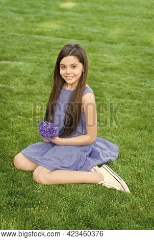 Relax, Unwind And Indulge. Happy Child Sit On Green Grass. Beauty Look Of Child Girl. Little Child W