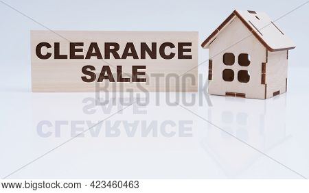 Economy And Business Concept. There Is A Wooden House And A Sign On The Table - Clearance Sale
