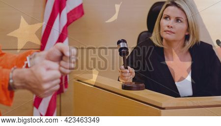Multiple stars against caucasian female judge knocking a gavel in the court room. american judiciary and law concept