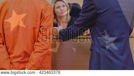 Multiple stars against mid section of criminal with lawyer signing documents at court room. american judiciary and law concept