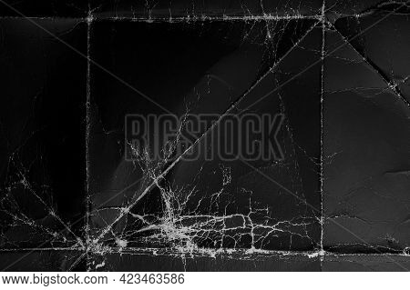 Black Folded Grunge Paper With Worn Wrinkles And Folds. Old Dusty Cardboard. Abstract Dramatic Backg
