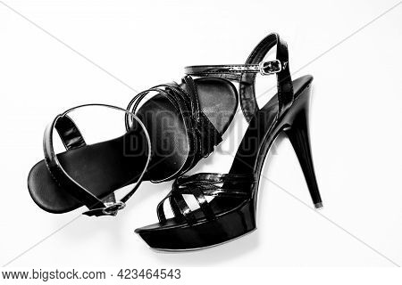 Beautiful Womens Shiny Patent Black Stiletto Sandals On A White Background