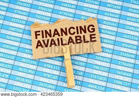 Business And Finance Concept. There Is Cardboard On The Financial Tables With The Inscription - Fina