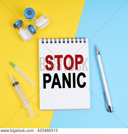 Medicine And Health Concept. A Syringe, Ampoules And A Notebook With The Inscription - Stop Panic