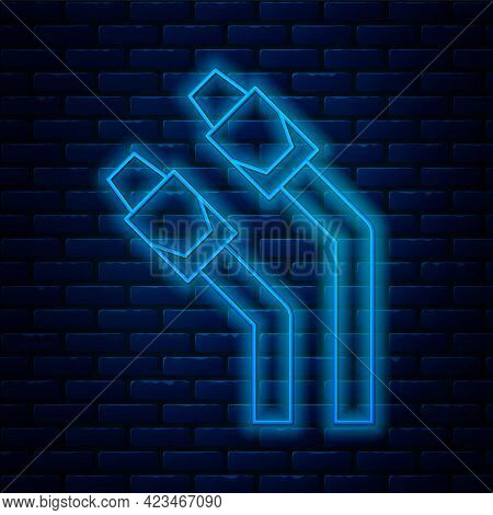 Glowing Neon Line Lan Cable Network Internet Icon Isolated On Brick Wall Background. Vector