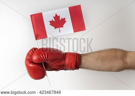 Boxing Glove With Canada Flag. Boxer Holds Flag Of Canada. White Background