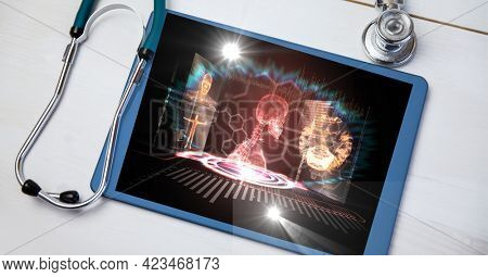 Composition of medical data processing on tablet with stethoscope. global medicine, technology and digital interface concept digitally generated image.