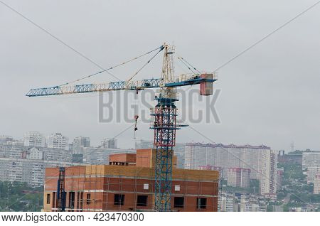 Construction Of A Multi-storey Building. A Crane Near An Unfinished House. Mortgages, Affordable Hou