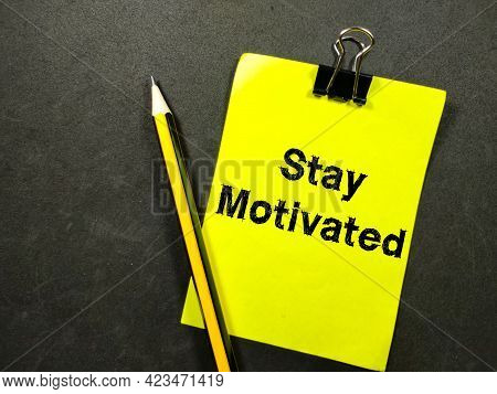 Motivation Concept.text Stay Motivated On Colorful Paper Note With Pencil On Black Background.