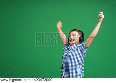 Full Of Emotions. Enjoying The Song Playing In Your Headphones. A Small Child Does Vocals On A Song,
