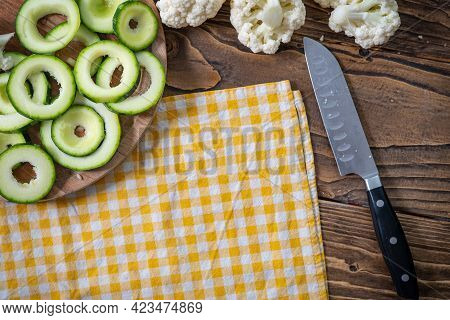 Fresh Vegetables Zucchini And Cauliflower Are Cut On A Cutting Board. Wooden Rustic Table Background