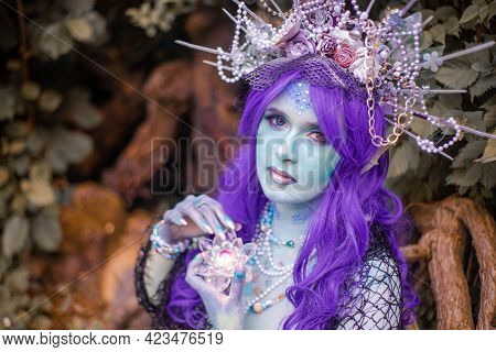 Fabulous Mermaid With Blue Skin In Foliage Close Up