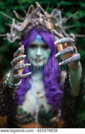 Fabulous Dark Mermaid With Blue Skin In The Forest Close Up