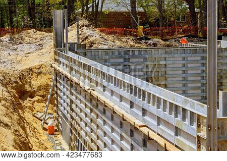 Building The Installation Of Formwork Under The Foundation Of A New House Of A Removable With Metal