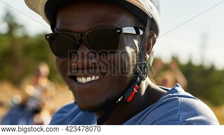 Close Up View Of Cheerful Young African American Man In Helmet For Driving Scooter And Sunglasses Ou