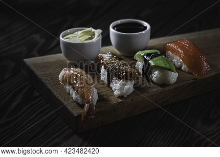 Traditional Japanese Dish - Nigiri Sushi. Rolls With Salmon, Eel, Tuna, Avocado, Royal Prawn. Tradit