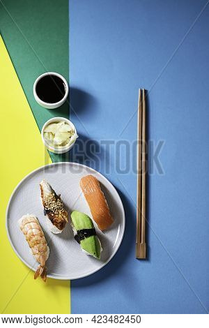 Set Of Nigiri Sushi Served On Plate On A Colorful Background. Delivery Service Japanese Food. Tradit