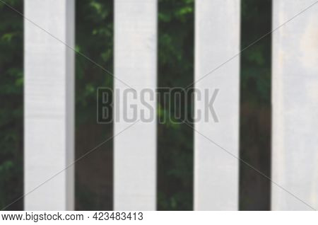 The Blurred Of The Lath. The Lath Has Been Painted White And Is Made Of Softwood Material.