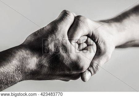 Rescue, Helping Hand. Male Hand United In Handshake. Man Help Hands, Guardianship, Protection. Black