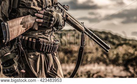 Hunting Period, Autumn Season. Male With A Gun. Hunter With A Backpack And A Hunting Gun. A Hunter W