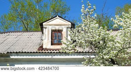 Old Slate Roof. Shingle Roof With Attic Window. The Courtyard Of Old Building Houses With Windows At