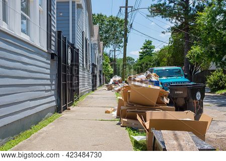 New Orleans, La - June 10: Pile Of Trash Left By University Students On Sidewalk Of Off Campus Apart
