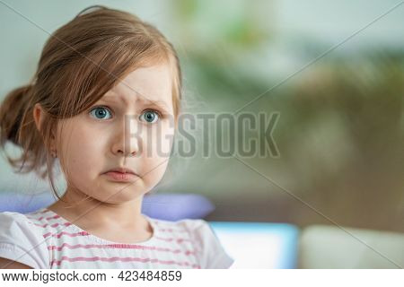 Discontented Little Girl Looks Indignantly With Big Eyes, Dissatisfied With Unfounded Claims, Receiv