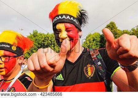 St. Petersburg, Russia - July 14, 2018: Smiling Belgian Fan Spectator In Kit, And Hat Looking Camera