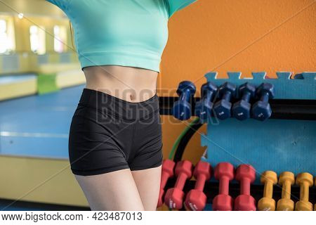 Sexy Sports Women's Abs Close-up. Beautiful Abs. Slim Woman