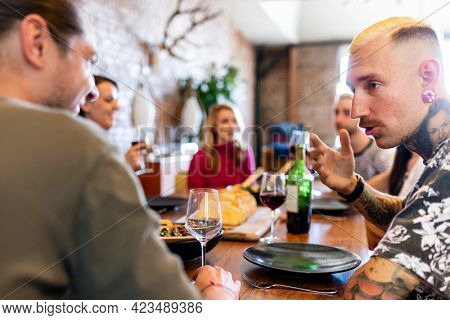 Friends having a serious conversation at a dinner party