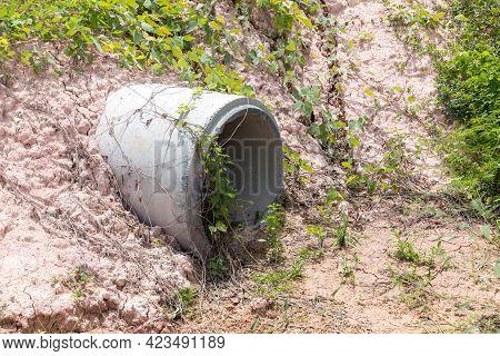 Concrete Circular Run-off Pipe Discharging Water. Sewage Pipe Polluting The River. Sewage Or Domesti