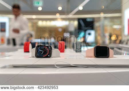 Multi-colored Apple Watch Series 6 In The Apple Store Window. Apple Authorized Shop. The Modern Shop