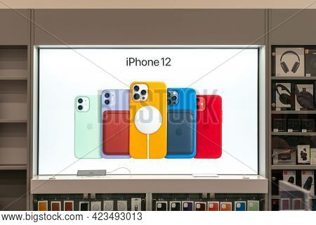 Advertising Scoreboard In The Store. Sale Of The New Apple Iphone 12 From Apple Inc. In A Shopping C