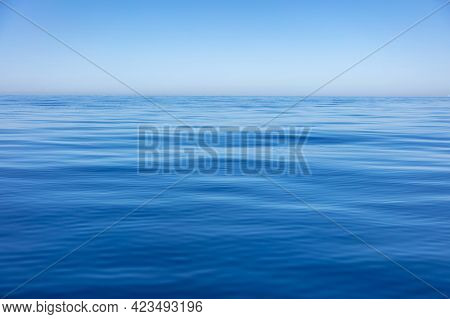 Sea Water Surface Calm With Small Ripples. Still Ocean, Deep Blue Color Background,