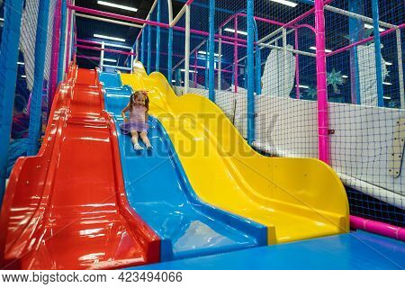 Happy Little Baby, 4 Year Old Girl, Children Ride Up, Down The Slide In The Play Center, Children's