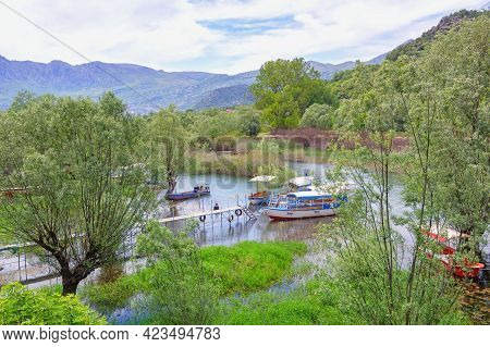 Montenegro. National Park Lake Skadar, Virpazar. Beautiful Mountain Landscape On Spring Day.  Boats