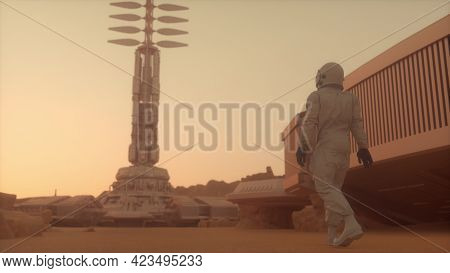 Astronaut Walking On The Surface Of Mars. Exploring Mission To Mars. Futuristic Colonization And Spa